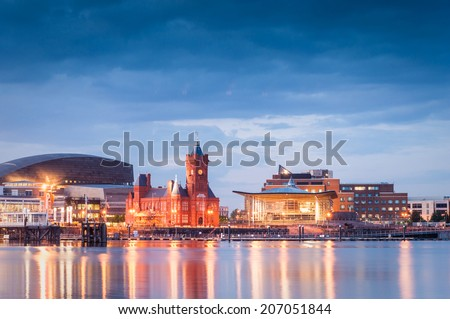 Pretty night time illuminations of the stunning Cardiff Bay, many sights visible including the Pierhead building (1897) and National Assembly for Wales. - stock photo