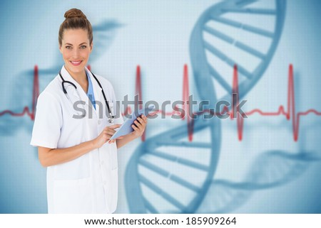 Pretty nurse using tablet pc against blue medical background with dna and ecg - stock photo