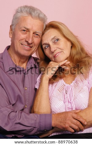 pretty old couple posing on a pink