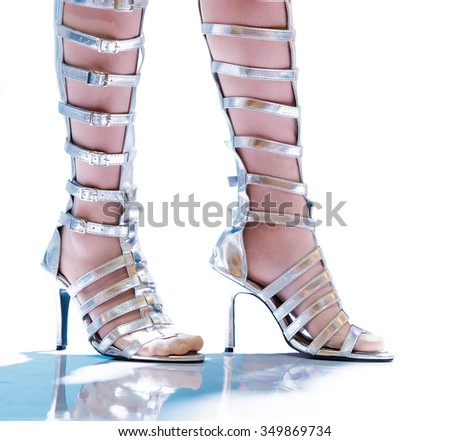 Pretty on catwalk with sandals boots.Close up only sandals boots and leg. - stock photo
