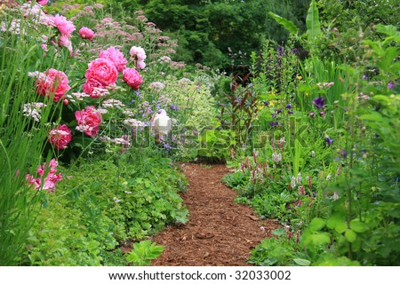Pretty path in an English cottage garden. - stock photo