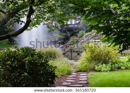 Pretty path in the beautiful summer garden - stock photo