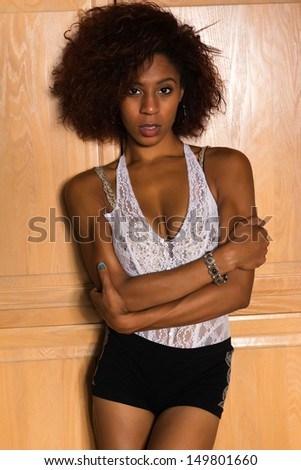 Pretty petite black woman in a white lace blouse - stock photo