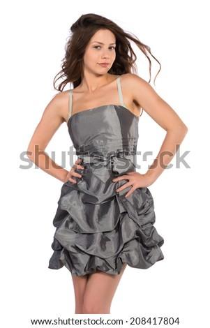 Pretty petite brunette in a gray dress - stock photo