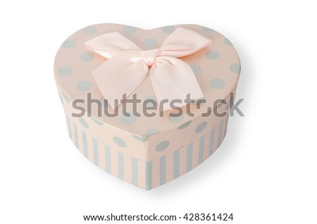 Pretty pink heart-shaped gift box isolated on white background
