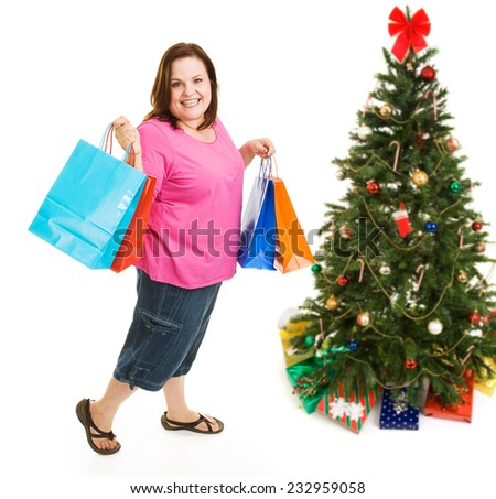 Pretty plus sized woman excited about bargain shopping for Christmas.  Full body isolatedo on white. - stock photo