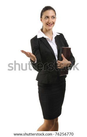 Pretty posing brunette in business costume holding laptop