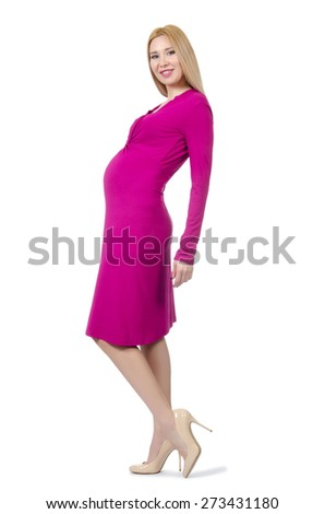 Pretty pregnant woman in pink dress isolated on white - stock photo