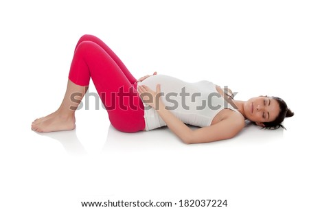 Pretty pregnant woman resting in her training isolated on white background - stock photo