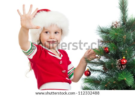 pretty preschool child decorating Christmas tree isolated on white - stock photo