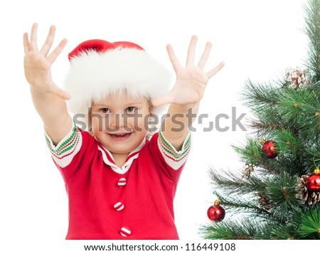 pretty preschool child near Christmas tree isolated on white - stock photo