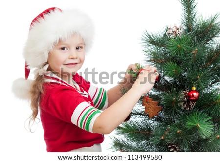 pretty preschool girl decorating Christmas tree isolated on white - stock photo