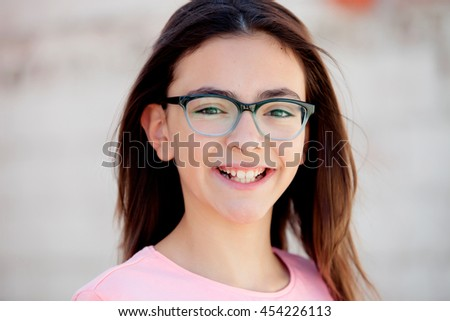 Pretty preteenager girl twelve years old with glasses outside