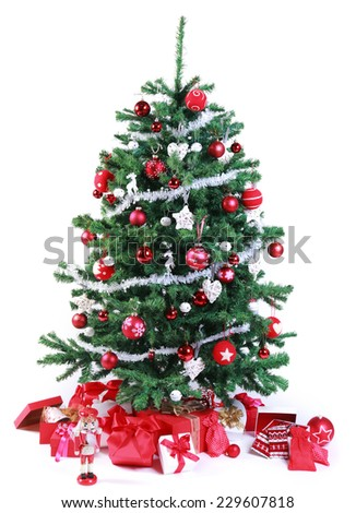 Pretty red and silver themed Christmas tree decorated with a tinsel garland and ornaments and surrounded by assorted shaped gift-wrapped boxes and presents in matching colors, isolated on white - stock photo