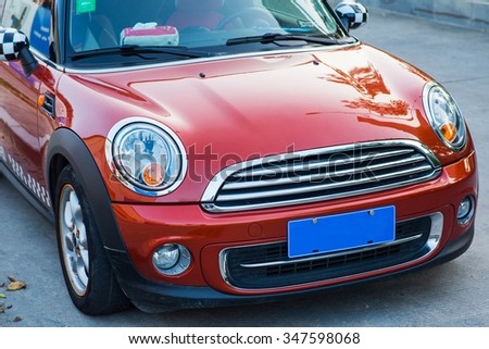 Pretty red car on highway - stock photo