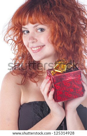 pretty red-haired girl with giftbox on white