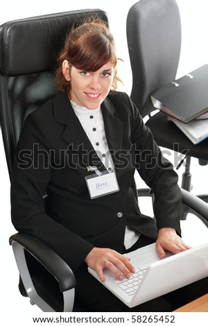 Pretty redhaired business lady or student working at a laptop