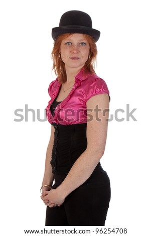 Pretty redhead girl in a pink blouse with a bowler