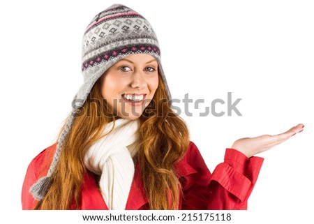 Pretty redhead in warm clothing on white background