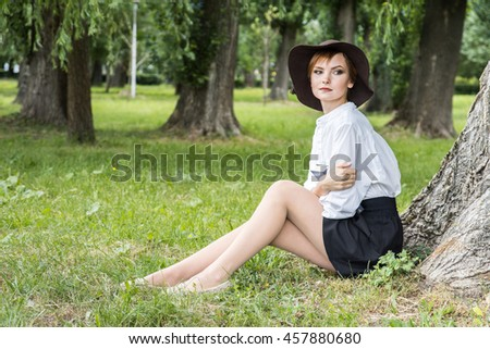 Pretty relaxed young woman reading a book
