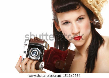 pretty retro summer funny girl in hat taking picture using vintage camera white background