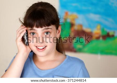 Pretty school girl using mobile  - stock photo