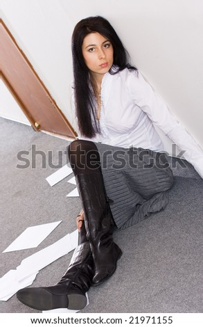 Pretty secretary dropped her papers on the floor