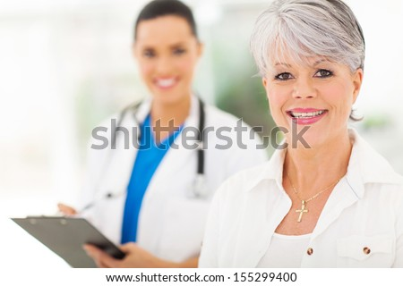 pretty senior woman in doctor's office - stock photo