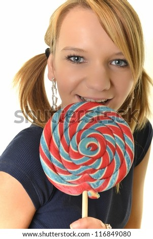 pretty sexy blonde woman with a lollipop in her hand - stock photo