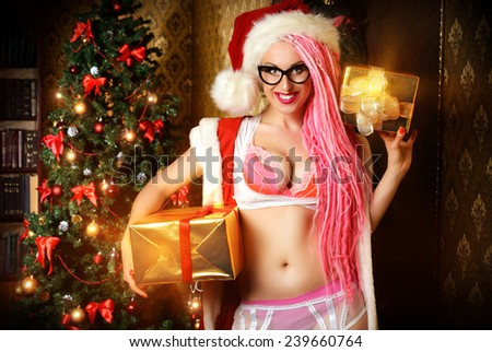 Pretty sexy girl wearing pink lingerie and pink hair alluring in the Christmas decoration.  - stock photo