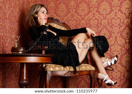 Pretty sexy woman talking on old telephone. Retro style