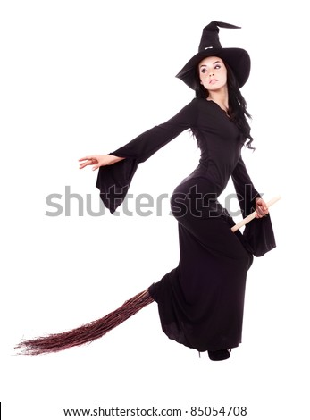 pretty sexy young brunette witch flying on a broom, isolated against white background - stock photo