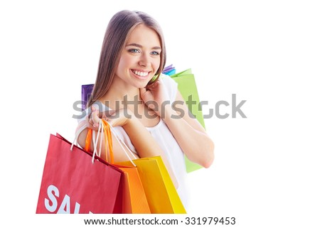 Pretty shopper with multi-color paperbags