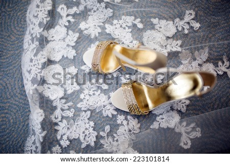 Pretty shot of wedding shoes and wedding dress - stock photo