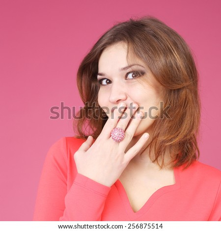 pretty shy young girl wearing a ring and a red dress