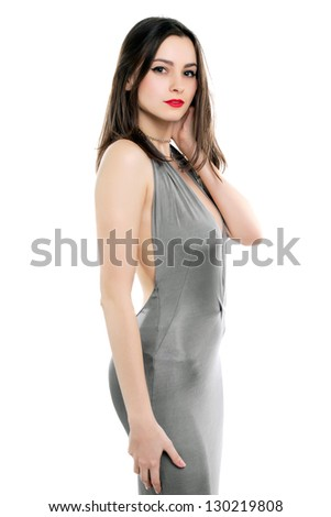 Pretty slim woman wearing sexy grey dress. Isolated on white - stock photo