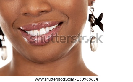pretty smile from black woman on white background - stock photo