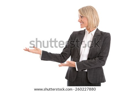 Pretty smiling businesswoman presenting with hands. Isolated female person over white background. - stock photo