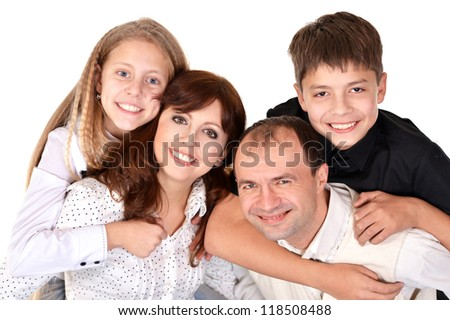 Pretty smiling family on a white background - stock photo
