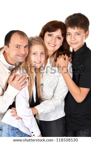 Pretty smiling family posing on a white background - stock photo