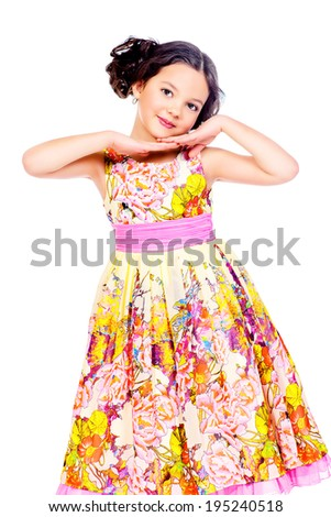 Pretty smiling girl in a beautiful summer dress. Isolated over white.