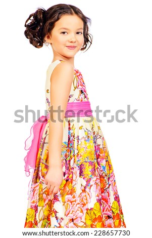Pretty smiling girl in a beautiful summer dress. Isolated over white. - stock photo