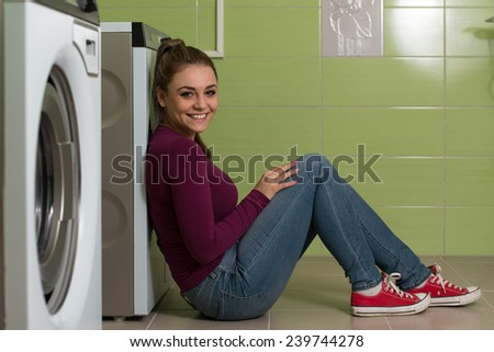 Pretty Smiling Girl In The Laundry Room - stock photo