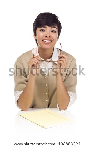Pretty Smiling Mixed Race Female Student at Desk with Books Isolated on a White Background. - stock photo