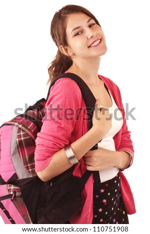 Pretty smiling teenage girl in fashionable back to school clothes carries backpack over shoulder. Pink sweater, white tank top, black short skirt. Vertical, isolated on white, copy space.