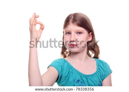 pretty smiling teenage girl showing okay sign - stock photo