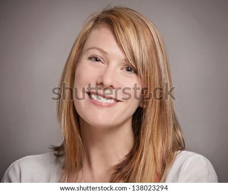Pretty smiling woman happy headshot portrait - stock photo