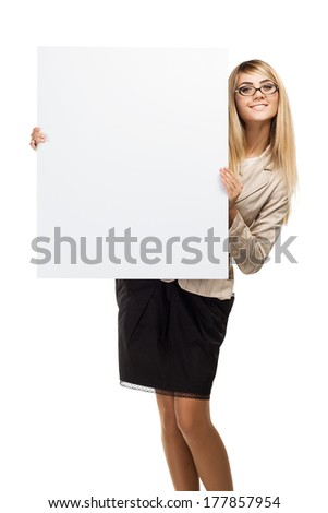 Pretty smiling woman holding a empty paper blank. Business woman - stock photo