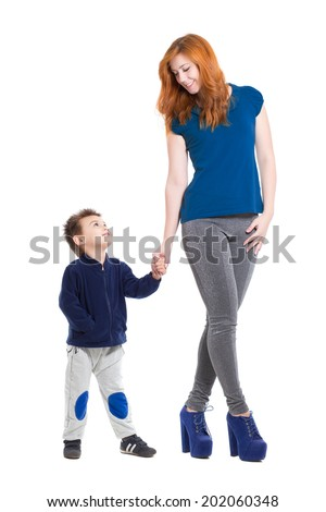 Pretty smiling woman posing with a little boy. Isolated on white - stock photo
