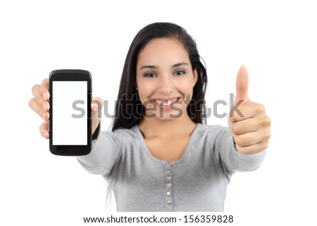 Pretty smiling woman showing a blank vertical smart phone screen and thumb up isolated on a white background                 - stock photo